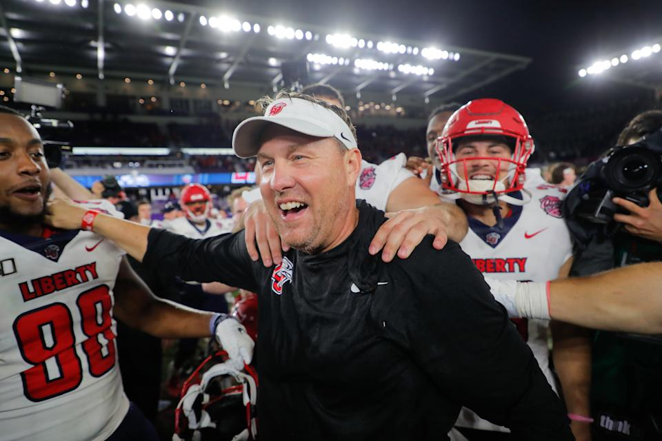 ORLANDO, FLORIDA - DECEMBER 21: Head coach Hugh Freeze of the Liberty Flames celebrates with his team after defeating the Georgia Southern Eagles in the 2019 Cure Bowl at Exploria Stadium on December 21, 2019 in Orlando, Florida. (Photo by James Gilbert/Getty Images)