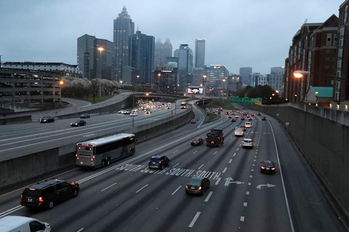 Lighter than normal early morning traffic moves in and out of downtown Atlanta Monday.