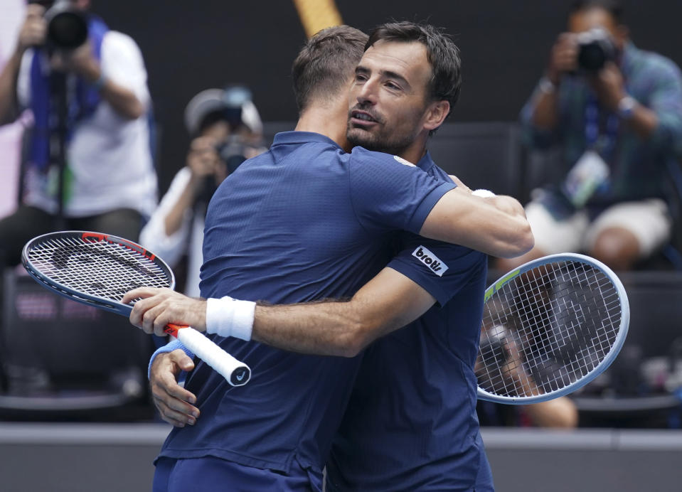 Croatia's Ivan Dodig, right, and Slovakia's Filip Polasek celebrate after defeating Rajeev Ram of the US and Britain's Joe Salisbury in the men's doubles final at the Australian Open tennis championship in Melbourne, Australia, Sunday, Feb. 21, 2021.(AP Photo/Mark Dadswell)