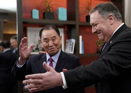 FILE PHOTO: U.S. Secretary of State Mike Pompeo stands with Vice Chairman of the North Korean Workers' Party Committee Kim Yong Chol, North Korea's lead negotiator in nuclear diplomacy with the United States, for talks aimed at clearing the way for a second U.S.-North Korea summit as they meet at a hotel in Washington, U.S., January 18, 2019. REUTERS/Joshua Roberts/File Photo