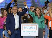 Colombian conservative Ivan Duque (L) celebrates his presidential election win with runningmate Marta Lucia Ramirez in Bogota