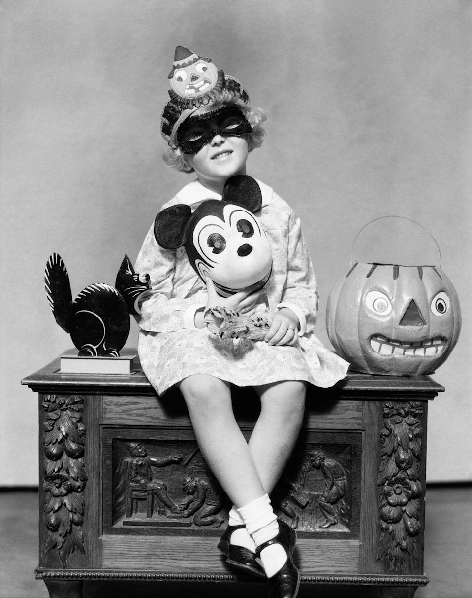 """<p>Mickey Mouse, who made his official debut in the 1928 animated short <em>Steamboat Willi</em><em>e</em>, became a popular character costume in the 1930s. This image appeared in the Halloween 1934 edition of the once-popular <a href=""""http://disney.wikia.com/wiki/File:Hallo_blog_1934_mag_halloween.JPG"""" rel=""""nofollow noopener"""" target=""""_blank"""" data-ylk=""""slk:family newspaper Grit"""" class=""""link rapid-noclick-resp"""">family newspaper <em>Grit</em></a>. </p>"""