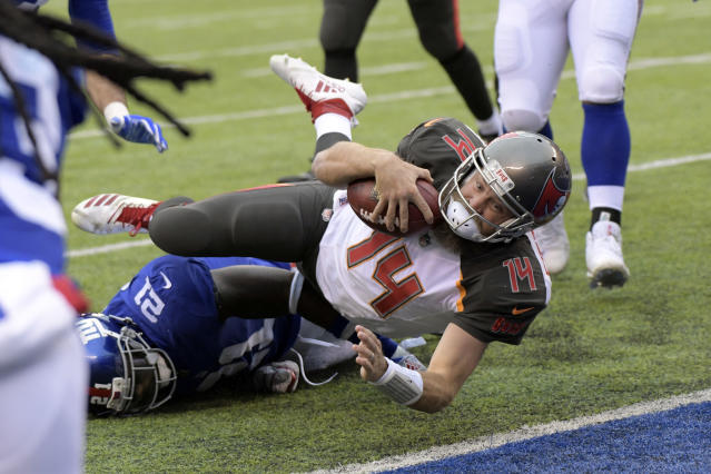 Tampa Bay Buccaneers quarterback Ryan Fitzpatrick makes a touchdown during the first half of an NFL football game against the New York Giants, Sunday, Nov. 18, 2018, in East Rutherford, N.J. (AP Photo/Bill Kostroun)