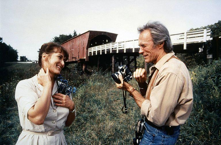 <p>Eastwood and Meryl Streep chat on the set of <em>The </em><em>Bridges of Madison County—</em>a performance that earned Meryl Streep an Oscar nomination for Best Actress.</p>