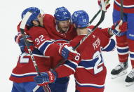 Montreal Canadiens' Corey Perry, centre, celebrates his goal with teammates Jeff Petry, left, and Eric Staal during the first period of an NHL Stanley Cup playoff hockey game in Montreal, Sunday, June 6, 2021. (Paul Chiasson/The Canadian Press via AP)