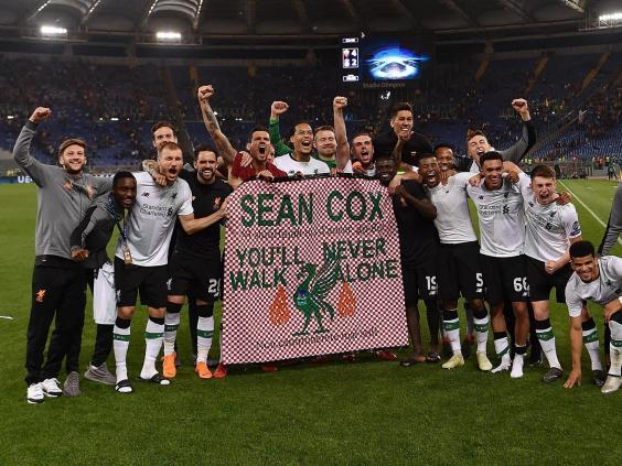 Liverpool players hold a message of support for Sean Cox in 2018 (Getty)
