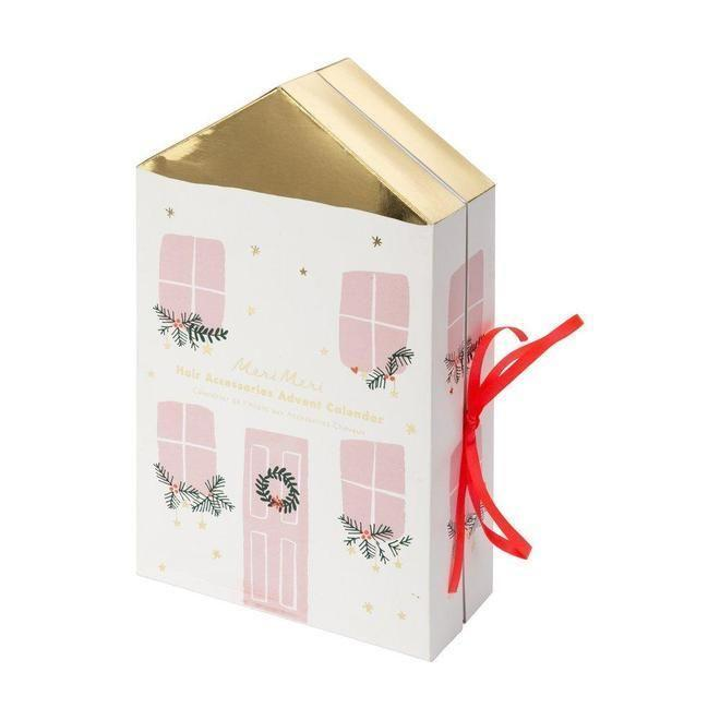 "<p><strong>The Plaid Giraffe</strong></p><p>plaidgiraffechildrensboutique.com</p><p><strong>$44.00</strong></p><p><a href=""https://plaidgiraffechildrensboutique.com/products/hair-ties-advent-calendar?variant=30726966706222"" rel=""nofollow noopener"" target=""_blank"" data-ylk=""slk:Shop Now"" class=""link rapid-noclick-resp"">Shop Now</a></p><p>If they can never find a scrunchie or love dressing up those top knots with barrettes, this cute one will be perfect. On second thought, I might need this for myself.</p>"