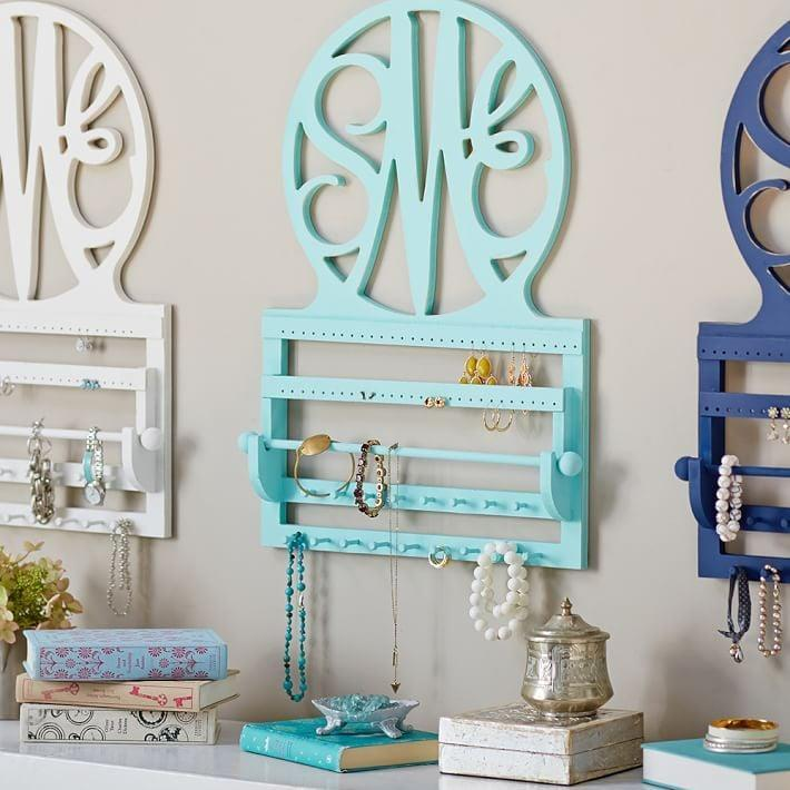 """<p>Jewelry-lovers are always looking for a fun place to store their earrings. This mint-green <a href=""""https://www.popsugar.com/buy/Script-Monogram-Wall-Jewelry-Storage-317764?p_name=Script%20Monogram%20Wall%20Jewelry%20Storage&retailer=pbteen.com&pid=317764&price=149&evar1=moms%3Aus&evar9=32519221&evar98=https%3A%2F%2Fwww.popsugar.com%2Ffamily%2Fphoto-gallery%2F32519221%2Fimage%2F43976609%2FScript-Monogram-Wall-Jewelry-Storage&list1=gifts%2Choliday%2Cgift%20guide%2Cpbteen%2Cgifts%20for%20kids%2Ckid%20shopping%2Choliday%20living%2Ctweens%20and%20teens%2Choliday%20for%20kids%2Cgifts%20for%20teens&prop13=api&pdata=1"""" class=""""link rapid-noclick-resp"""" rel=""""nofollow noopener"""" target=""""_blank"""" data-ylk=""""slk:Script Monogram Wall Jewelry Storage"""">Script Monogram Wall Jewelry Storage</a> ($149) has spaces for earrings, necklaces, bracelets, and more. Plus, you can customize it with their initials.</p>"""
