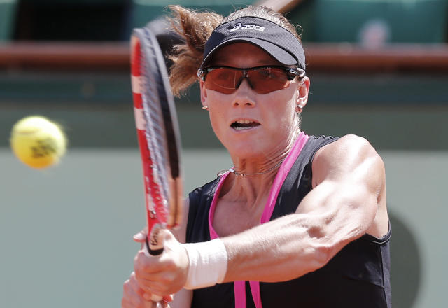 Australia's Samantha Stosur returns the ball to Italy's Sara Errani during their semifinal match in the French Open tennis tournament at the Roland Garros stadium in Paris, Thursday, June 7, 2012. (AP Photo/Michel Euler)