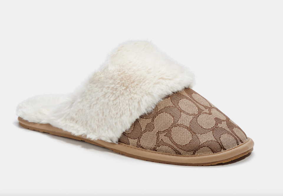 coach Ziva Slipper with cc print and sherpa (Photo via Coach Outlet)