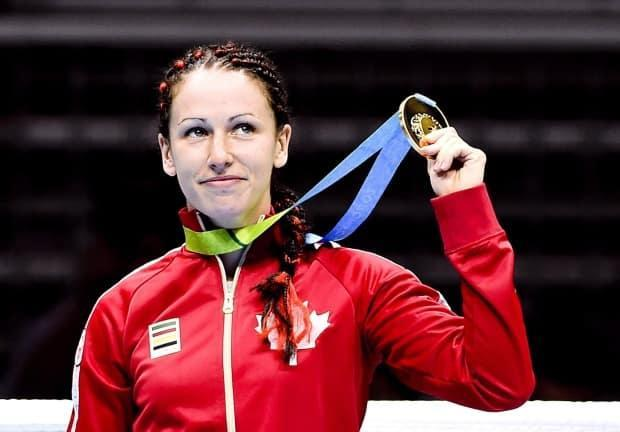 The Canadian government has come out in support of boxer Mandy Bujold, penning a letter to IOC president Thomas Bach asking the organization to reconsider its decision to keep the Kitchener, Ont., native from competing in Tokyo. (Nathan Denette/The Canadian Press - image credit)