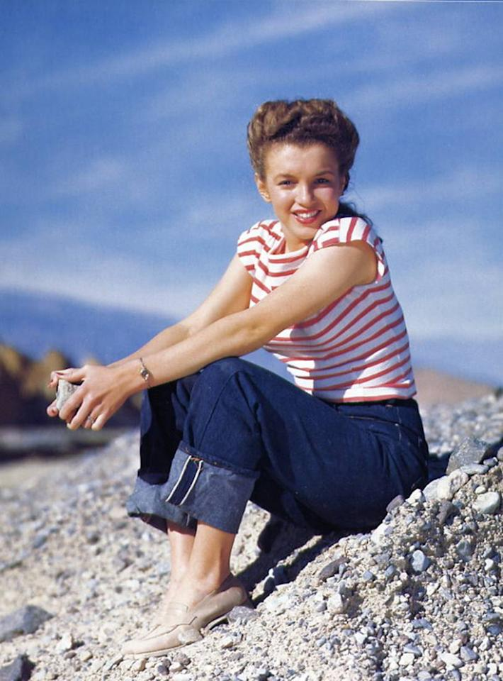 <p>Teenage toughs weren't the only ones who made 501s their own. Here, the style is worn by young model Norma Jean Baker just before she became the peroxide-blond bombshell Marilyn Monroe. Bonus points for turning up those cuffs so we can see the selvage.</p><p><i>(Photo: Richard C. Miller/Getty)</i></p>