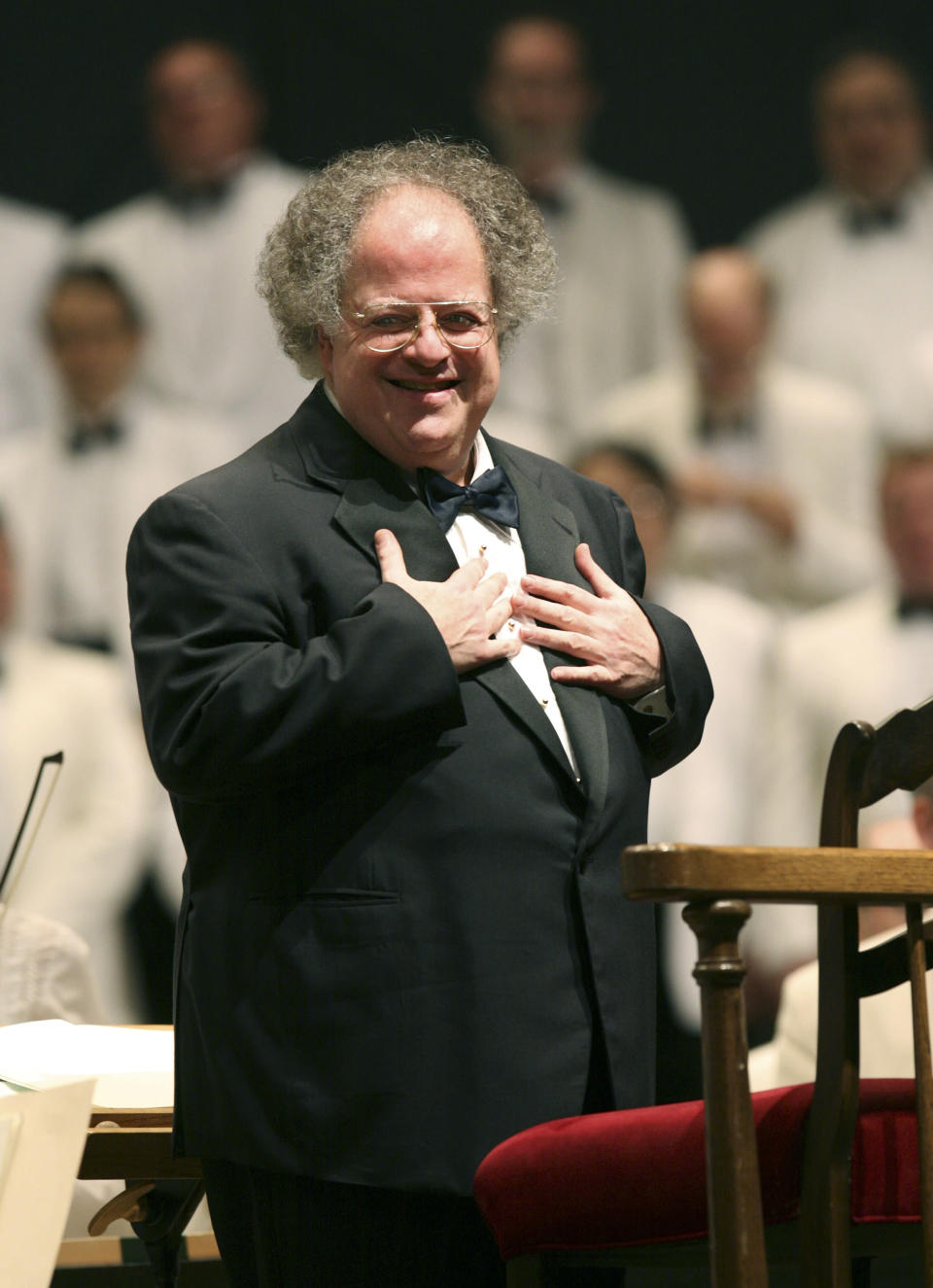 FILE - Boston Symphony Orchestra music director James Levine appears during a performance at Tanglewood in Lenox, Mass., on July 7, 2006. Levine, who ruled over the Metropolitan Opera for 4 1/2 decades before being eased out when his health declined and then fired for sexual improprieties, died March 9, 2021 in Palm Springs, Calif., of natural causes, his physician of 17 years, Dr. Len Horovitz, said Wednesday, March 17. He was 77. (AP Photo/Michael Dwyer, File)