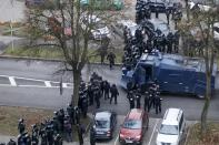 Belarusian riot police block the road to stop demonstrators during an opposition rally to protest the official presidential election results in Minsk, Belarus, Sunday, Nov. 15, 2020. Protests have rocked Belarus since the August election that official results say gave Lukashenko a sixth term in office but that opponents and some polls workers claim were manipulated. (AP Photo)