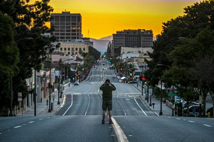 Pasadena, CA - January 01: First time since 1945, the Rose Parade in Pasadena has been cancelled due to COVID-19 pandemic. Jim Safford stops by to take a photo of deserted Colorado Blvd. on Friday, Jan. 1, 2021 in Pasadena, CA. (Irfan Khan / Los Angeles Times)