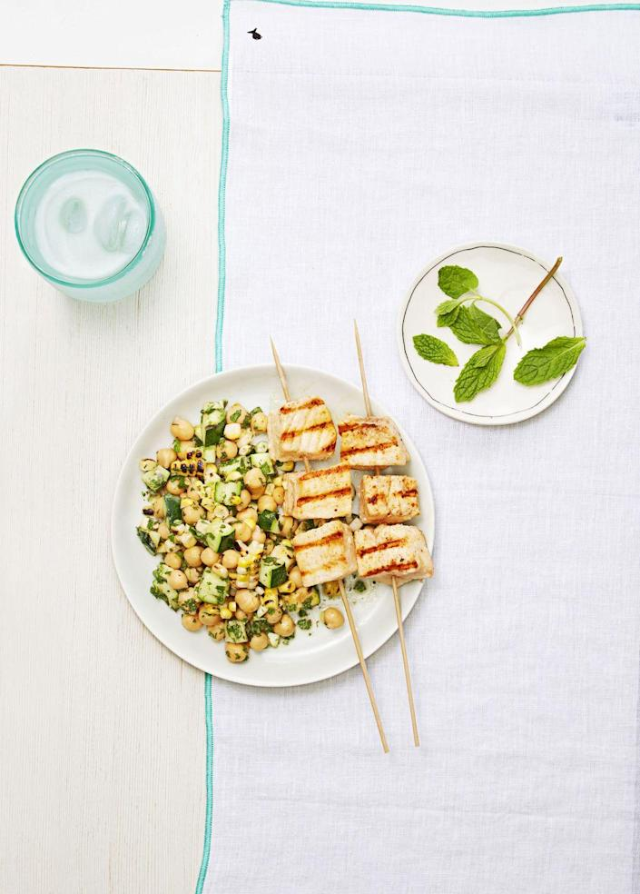 """<p>Catching yourself in a salmon or tilapia rut? Take a chance on swordfish, especially in the summer season, as this hearty protein grills perfectly.</p><p><a href=""""https://www.goodhousekeeping.com/food-recipes/easy/a33396/swordfish-summer-salad/"""" rel=""""nofollow noopener"""" target=""""_blank"""" data-ylk=""""slk:Get the recipe for Swordfish With Summer Salad »"""" class=""""link rapid-noclick-resp""""><em>Get the recipe for Swordfish With Summer Salad »</em></a></p>"""