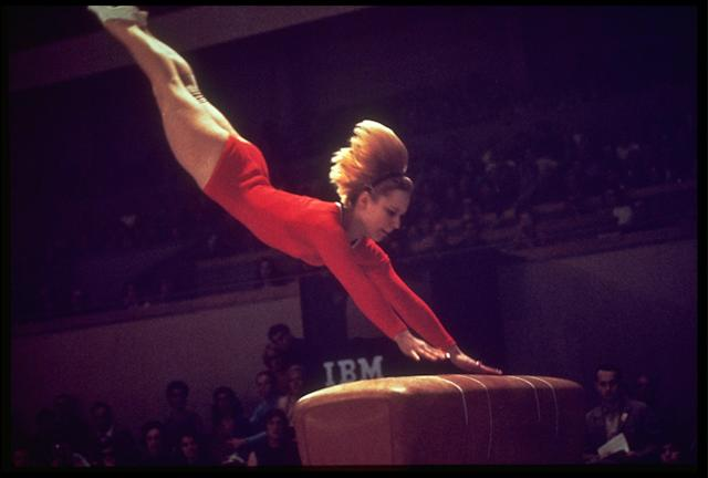 25 OCT 1968: VERA CASLAVSKA OF CZECHOSLOVAKIA IN ACTION DURING THE SIDE HORSE VAULT COMPETITION AT THE 1968 SUMMER OLYMPICS HELD IN MEXICO CITY. CASLAVSKA WON THE VAULT EVENT WITH A SCORE OF 19.775 POINTS.
