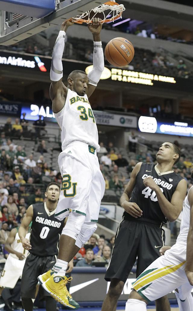 Baylor forward Cory Jefferson (34) slam dunks as Colorado defenders Josh Scott (40) and Askia Booker look on during the first half of an NCAA college basketball game in Dallas, Friday, Nov. 8, 2013. (AP Photo/LM Otero)