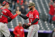 Cincinnati Reds catcher Tyler Stephenson, left, congratulates relief pitcher Tejay Antone after Antone got Colorado Rockies' Garrett Hampson to ground into a double play to end the ninth inning of a baseball game Sunday, May 16, 2021, in Denver. (AP Photo/David Zalubowski)