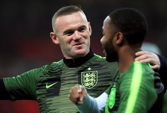 Rooney and Raheem Sterling in conversation during the warm-up