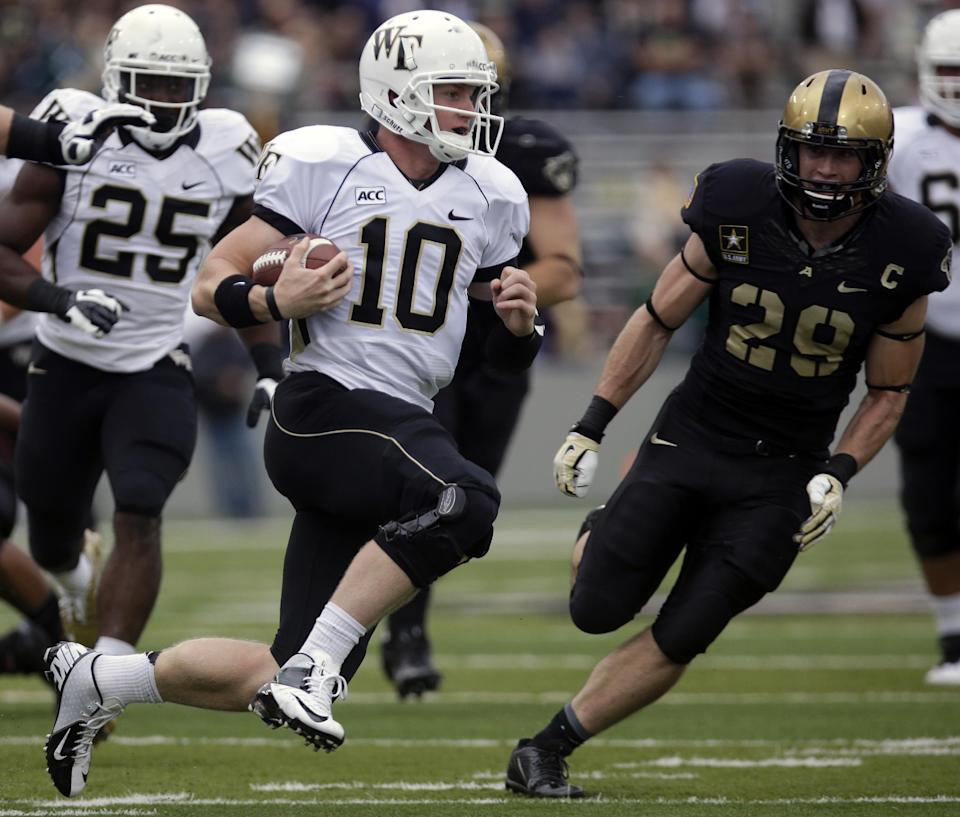 Wake Forest quarterback Tanner Price (10) runs past Army linebacker Thomas Holloway (29) during the first half of an NCAA college football game on Saturday, Sept. 21, 2013, in West Point, N.Y. (AP Photo/Mike Groll)