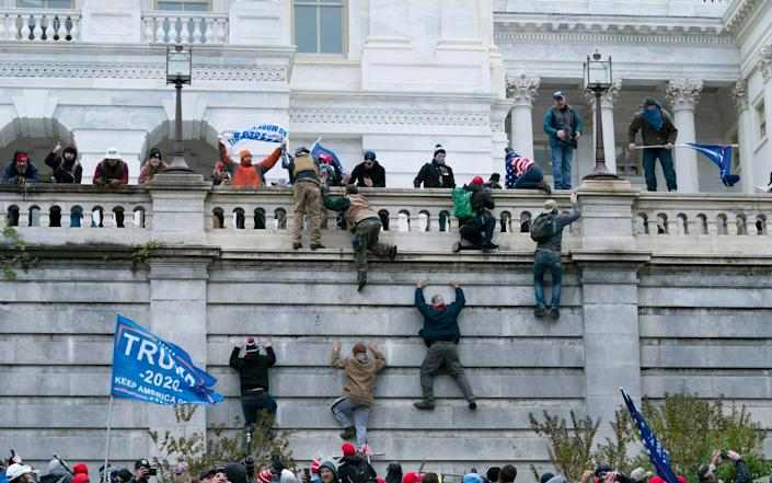 Trump supporters scale the West Wall of the Capitol unopposed, supposedly one of the most secure buildings in the world Jan 6, 2021 - Jose Luis Magana /AP