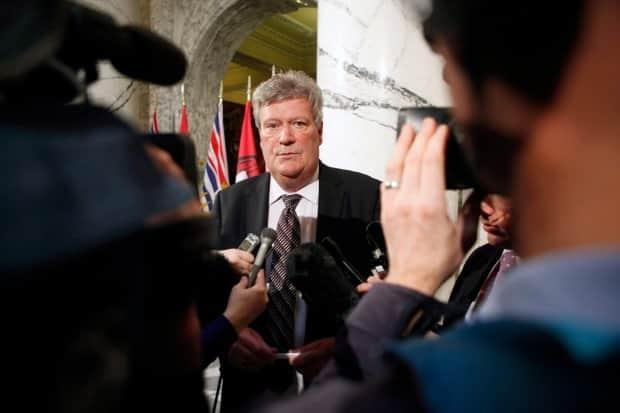 Then-minister Rich Coleman speaks to media in Victoria on Feb. 15, 2017. Coleman told the Cullen inquiry into money laundering in B.C. on April 23 he never turned a blind eye to the problem during his decades in cabinet. (Chad Hipolito/The Canadian Press - image credit)