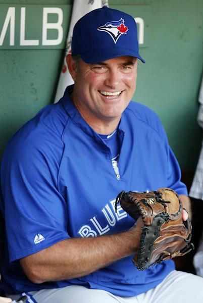 FILE - In this Sept. 7, 2012, file photo, Toronto Blue Jays manager John Farrell sits in the dugout before the Blue Jays' baseball game against the Boston Red Sox in Boston. The Red Sox reportedly have reached an agreement to bring Farrell to Boston to replace Bobby Valentine. Red Sox spokeswoman Pam Kenn said early Sunday, Oct. 21, 2012, the team had no announcement to make. Comcast SportsNet New England reported that the deal was agreed to. (AP Photo/Michael Dwyer, File)
