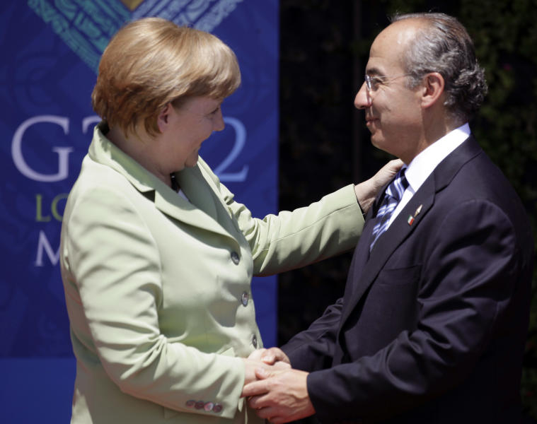 German Chancellor Angela Merkel, left, greets Mexico's President Felipe Calderon during the opening ceremony of the G20 Summit in Los Cabos, Mexico, Monday, June 18, 2012. (AP Photo/Eduardo Verdugo)