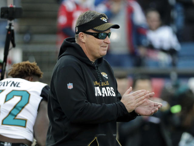 Jacksonville Jaguars head coach Doug Marrone watches his team warm up before the AFC championship NFL football game against the New England Patriots, Sunday, Jan. 21, 2018, in Foxborough, Mass. (AP Photo/David J. Phillip)