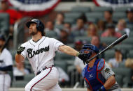 Atlanta Braves pinch hitter Charlie Culberson, left, follows through on a walkoff two-run home run in the ninth inning of the first game of a baseball doubleheader against the New York Mets, Monday, May 28, 2018, in Atlanta. (AP Photo/John Bazemore)