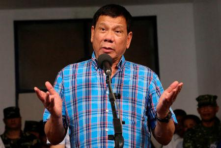 Philippine President Rodrigo Duterte gestures during a briefing with the military after his visit at Camp General Basilio Navarro in Zamboanga City