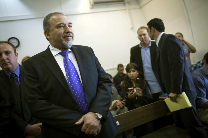 Former Israeli Foreign Minister Avigdor Lieberman waits in the courtroom before hearing the verdict in his trial on Wednesday, Nov. 6, 2013, at the Magistrates Court in Jerusalem. The Israeli court on Wednesday found Lieberman innocent of all charges in the graft trial, clearing the way for the powerful hard-line politician to return to his post as the nation's top diplomat. (AP Photo/Emil Salman, Pool)