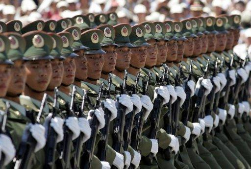 """Chinese soldiers take part in a 2004 parade to mark the establishment of new miltary barracks. China has warned that American criticism of its decision to set up a new military garrison in the South China Sea sent the """"wrong signal"""" and threatened peace in the hotly disputed waters"""