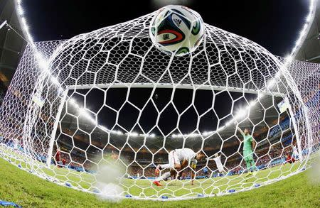 Dempsey of the U.S. knocks the ball into the net to score against Portugal during their 2014 World Cup Group G soccer match at the Amazonia arena in Manaus