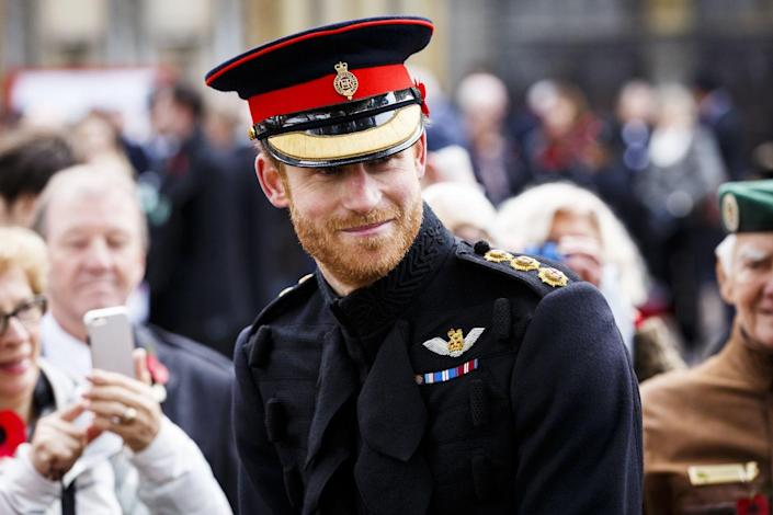 """<p>Harry steps out in full uniform while participating in Remembrance Day ceremonies in London. Earlier that week, he <a href=""""https://www.cosmopolitan.com/entertainment/celebs/a8673228/prince-harry-meghan-markle-dating-timeline/"""" rel=""""nofollow noopener"""" target=""""_blank"""" data-ylk=""""slk:released a rare statement"""" class=""""link rapid-noclick-resp"""">released a rare statement</a> to confirm his relationship with Meghan and more importantly, to request that the media and social media trolls stop the """"wave of abuse and harassment"""" against his girlfriend and her family. """"This is not a game—it is her life and his"""" read part of his statement.</p>"""