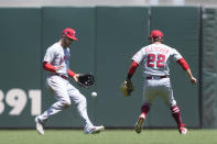 Los Angeles Angels center fielder Taylor Ward, left, cannot make the catch on a popup fly hit by San Francisco Giants' Steven Duggar as shortstop baseman David Fletcher (22) looks on during the third inning of a baseball game Monday, May 31, 2021, in San Francisco. (AP Photo/Tony Avelar)