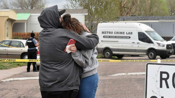PHOTO: Freddy Marquez kisses the head of his wife, Nubia Marquez, near the scene where her mother and other family members were killed in a mass shooting early Sunday, May 9, 2021, in Colorado Springs, Colo. (Jerilee Bennett/The Gazette via AP)