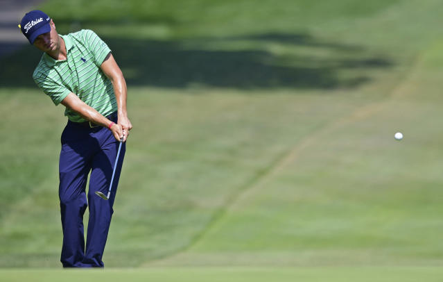 Justin Thomas watches his approach shot on the sixth hole during the final round of the Bridgestone Invitational golf tournament at Firestone Country Club, Sunday, Aug. 5, 2018, in Akron, Ohio. (AP Photo/David Dermer)