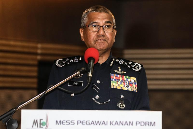 Inspector-General of Police Tan Sri Mohamad Fuzi Harun confirmed today the release of two men detained over the alleged theft of a 23kg Radioactive Dispersal Device (RDD) worth RM75,000. — Picture by Hari Anggara