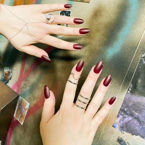 """<p>At the Monse show, manicurist Miss Pop paired a matte berry-red nail polish with a pierced ring at the tip for a little punk element. </p><p>Essie Berry Naughty, $8.99, <a href=""""https://www.target.com/p/essie-nail-polish-berry-naughty-0-46-fl-oz/-/A-13249621"""" rel=""""nofollow noopener"""" target=""""_blank"""" data-ylk=""""slk:target.com"""" class=""""link rapid-noclick-resp"""">target.com</a>. <a class=""""link rapid-noclick-resp"""" href=""""https://www.target.com/p/essie-nail-polish-berry-naughty-0-46-fl-oz/-/A-13249621"""" rel=""""nofollow noopener"""" target=""""_blank"""" data-ylk=""""slk:SHOP"""">SHOP</a></p><p><a href=""""https://www.instagram.com/p/B8UkYdmlrxJ/"""" rel=""""nofollow noopener"""" target=""""_blank"""" data-ylk=""""slk:See the original post on Instagram"""" class=""""link rapid-noclick-resp"""">See the original post on Instagram</a></p>"""