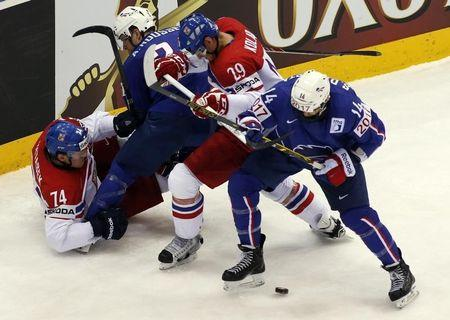 Vitasek and Kolar of the Czech Republic battle for the puck with France's Roussel and Stephane da Costa during the first period of their men's ice hockey World Championship Group A game at Chizhovka Arena in Minsk