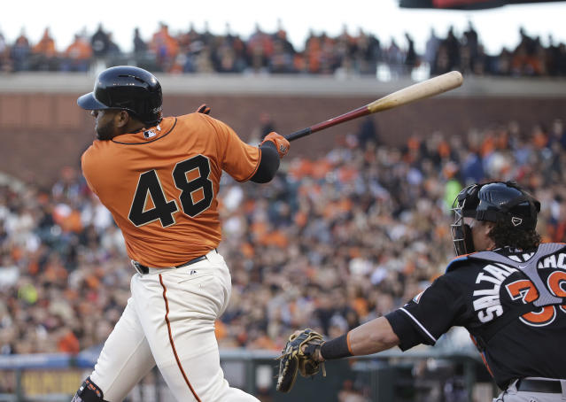 San Francisco Giants' Pablo Sandoval hits an RBI double off Miami Marlins starting pitcher Henderson Alvarez as Marlins catcher Jarrod Saltalamacchia watches during the first inning of a baseball game Friday, May 16, 2014, in San Francisco. (AP Photo/Eric Risberg)