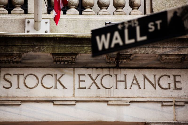 FILE PHOTO: A street sign for Wall Street hangs in front of the New York Stock Exchange