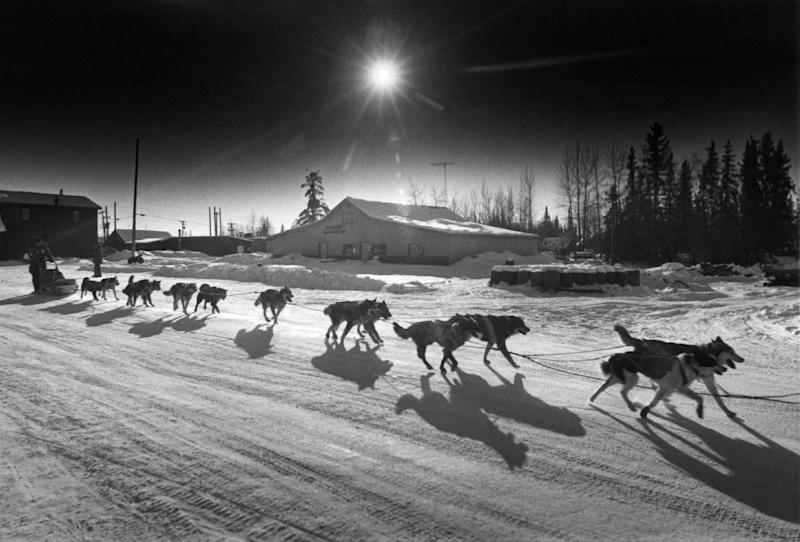 FILE - Last year's winner and veteran dog musher Susan Butcher pulls into this checkpoint in the heat of the day in McGrath, Alaska, March 12, 1987. (AP Photo/Rob Stapleton, File)