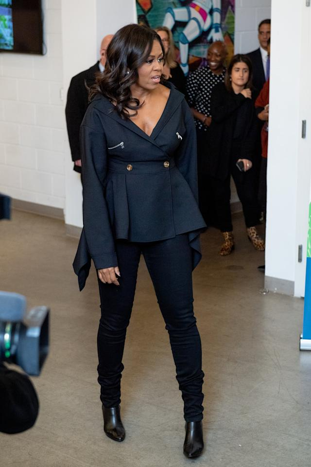 <p>In December 2018, Michelle Obama made an appearance in New York to promote her memoir. For the occasion, she wore skinny jeans with a top by Adeam and black boots.</p>