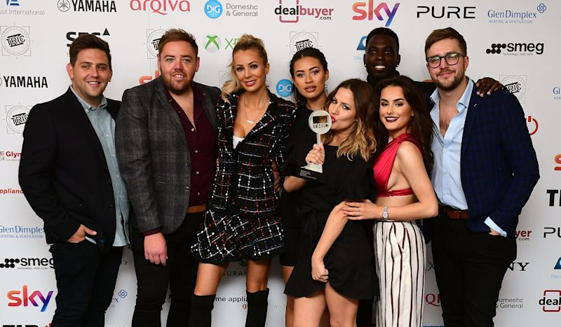 Amber Davies (second right), Montana Brown (centre left), Olivia Attwood (third left), Caroline Flack (centre right), Ian Sterling (far right) and Marcel Somerville with the Reality Programme Award for Love Island at during the 2018 TRIC Awards at the Grosvenor House Hotel, London. (Photo by Ian West/PA Images via Getty Images)