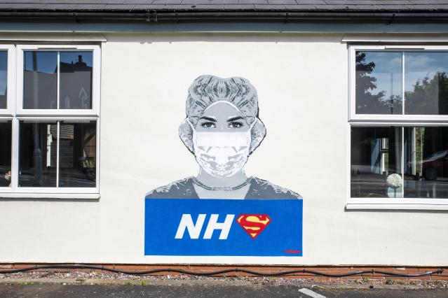 A piece of street art of a nurse in honour of NHS staff during the coronavirus pandemic, recently painted by street artist John Doh, on a wall of The Bull Inn in Fernhill Heath, Worcestershire. (PA)