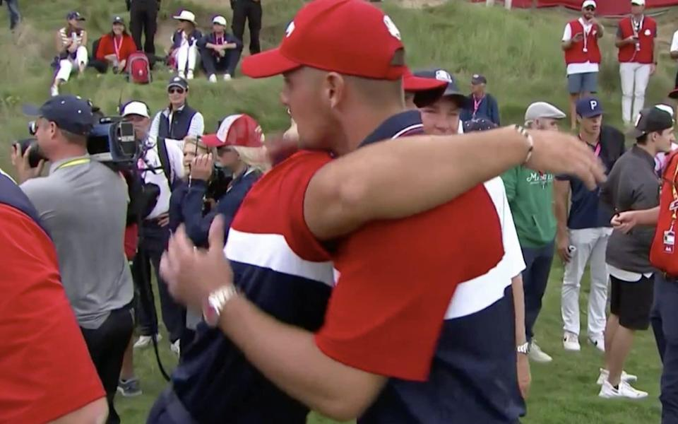 The two Americans embraced on the 18th green