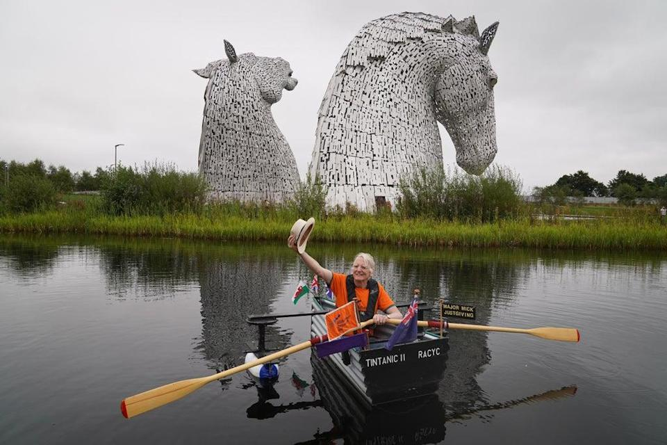 Michael Stanley rows his boat Tintanic II along the Forth and Clyde Canal past the Kelpies (Andrew Milligan/PA) (PA Wire)